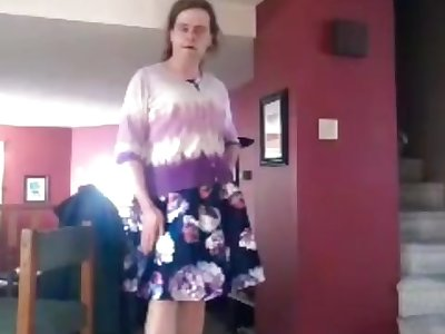 Crossdresser in floral print dress