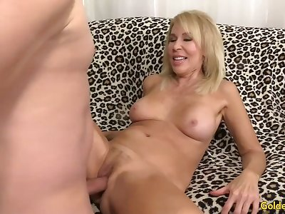 Mature blonde shows off her pussy and fucks