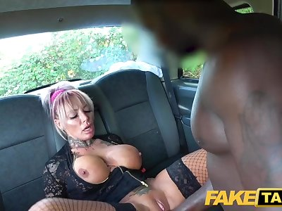 Faux Taxi Sexy busty tattooed Milf stripper wants big black trouser snake