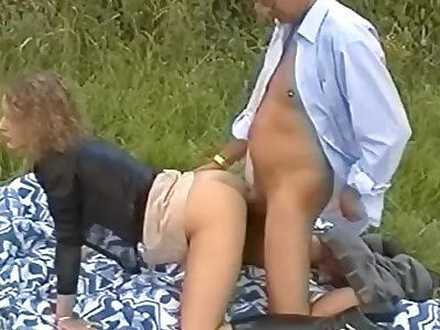 Old grey haired guy fucks younger damsel outdoors