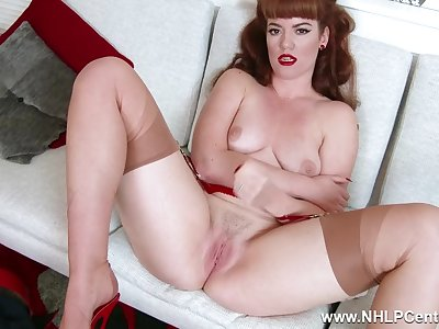 Redhead Zoe Page teases her pert tits and wet pussy in retro red undergarments